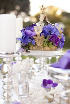 Love the silver candle holder and the flowers on a cake stand idea. Love the crown would be good for the King's table.  Could have a different theme on each table or a different crown