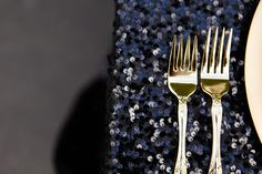 Gold silverware on a black-glitter table - so glam/punk!
