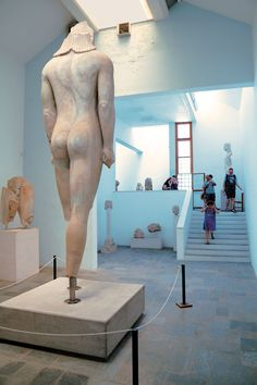 """In the Archaeological Museum of Samos Town, amongst other things finds from Ireon are exhibited, as well as the colossal Kouros. Kouros of Samos is an ancient sculpture created in the 6th century BCE. The inscription on its left thigh reads: """"Isches, son of Rhesis, set this up"""". It stands nearly 5.5 meters tall (!) and its body is mostly intact. Originally it was one of the several colossal statues lining the route to the sanctuary of goddess Hera on Samos. #kouros #museum #samos #greece"""