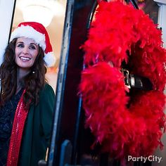 Dress up your door with a Santa suit Christmas wreath made from a red feather boa and belt! Click the pic for the easy DIY instructions.