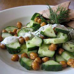 Roasted Chickpeas and Cucumber Salad ...seems light enough to eat in the summer but will fill you up!