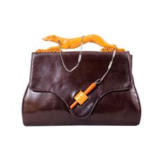 Rare Art Deco Bakelite Greyhound on a Leash Leather Clutch | From a collection of rare vintage handbags and purses at http://www.1stdibs.com/fashion/accessories/handbags-purses/