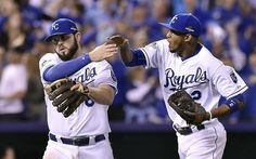 Kansas City Royals shortstop Alcides Escobar, right, congratulated third baseman Mike Moustakas after Moustakas caught a line drive hit by Toronto Blue Jays third baseman Josh Donaldson for the final out of the top of the fifth inning during Friday's ALCS baseball game on October 23, 2015 at Kauffman Stadium in Kansas City, Mo.