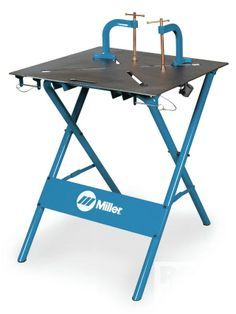 My Miller portable welding table, great for a small shop. And I love the clamps !!!