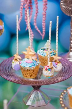 The cupcakes and cake pops at this Under the sea 1st birthday  party are amazing! See more party ideas and share yours at CatchMyParty.com #catchmyparty #partyideas  #undertheseaparty #girl1stbirthdayparty #mermaidparty #undertheseacupcakes #undertheseacakepops