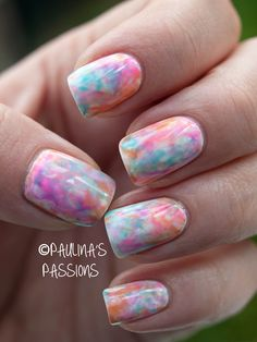 HOW TO :: Watercolor Nails by #paulinaspassions :: She used 3 colors--blue, orange & pink (click for names) & put a drop of each color onto foil. Using a thin nail art brush, she dissolved each color w/ acetone dabbed onto nails in random shapes (I'm assuming) w/ a makeup sponge.