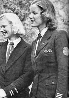 Two Norwegian officers of the 'Gjentehird' (A faction of a youth organization fashioned after the Hitler Youth/BDM, for ages 14 to 18 yrs). The girl on the right wears German 'Distinguished Foreigner Decoration.'