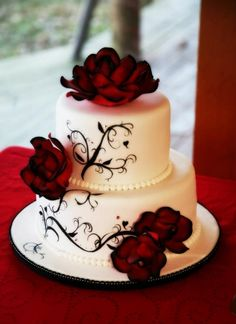chocolate cake with a mocha buttercream icing and MMF. Handpainted Scroll work and handmade gum paste roses, airbrushed edges with disco dust applied using piping gel.