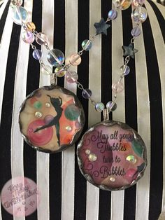 These are my latest beveled glass, soldered jewelry medallions to celebrate my love for Bubbles! They all flaunt a vintage image of a darling, nude silhouette amidst colorful bubbles! More details on my website!