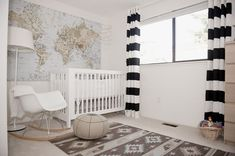 Modern Travel Nursery featuring black and white striped curtains! So chic.
