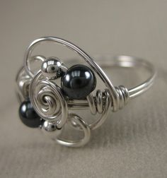 Wire Wrapped Ring Hematite and Sterling Silver by holmescraft, $22.00 (IF YOU DO IT, IT'S BETTER AND YOU CAN GIVE IT YOUR PERSONAL TOUCH)