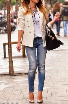 There's just something about this that I like.  Nix the ripped jeans but I like a blazer/t-shirt and the snake skin heels are very cool.