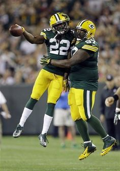 Green Bay Packers' Jerron McMillian (22) celebrates his interception with teammate Johnny Jolly (97) during the first half of an NFL preseason football game against the Seattle Seahawks Friday, Aug. 23, 2013, in Green Bay, Wis. (AP Photo/Tom Lynn)