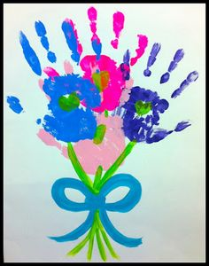 Pretty handprint flower bouquet. 14 different handprint flower projects for Mother's Day or just because. These are really cute!!