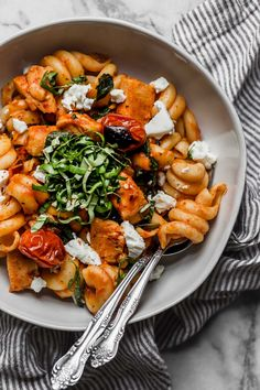 date night pasta pomodoro with chicken & goat cheese is the perfect easy pasta dinner recipe! made with chicken, spinach, goat cheese, and a homemade roasted red pepper pomodoro sauce, this pasta pomodoro with chicken & goat cheese is on your table in 25 minutes or less, tastes totally fresh, & is perfect for date night! #playswellwithbutter #easypastarecipe #pastapomodoro #pastadinner #italianrecipe