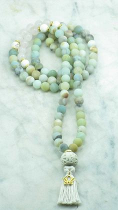Alchemy Mala - 108 Amazonite and Rose Quartz Mala Beads  This elegant mala is made from amazonite mala beads. These healing energy gemstones empower us to manifest our dreams and desires, and magnify our intentions. Holding these Buddhist prayer beads while affirming aloud what one wishes for can be a powerful enhancement to bringing that wish into being. Amazonite is a gemstone of feminine energy, and opens the heart and throat chakra. Rose quartz is a gemstone of love, love of self, love…