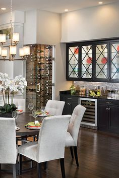 This luxury kitchen features a wine cabinet. The kitchen also features a luxury eat in area for busy families. See kitchen ideas on the website.