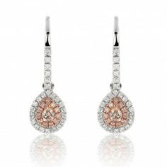 A supremely classy and dainty look for everyday wear, this pair of 18K two-tone gold earrings features a pair of pear-shaped Fancy Light Pink Brown diamonds surrounded by a double halo of round diamonds. The inner rims comprise 22 round Light to Fancy Pink to Purplish Pink diamonds. The outer rims comprise white round diamonds that also accent the leverback hooks.