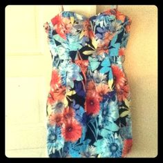 Bright Flower dress Beautiful flower dress!! It's in very good condition, the only part that needs fixed is the strap :( all it need is a loop or stitching to put back together otherwise it's as good as new! Candie's Dresses