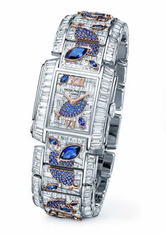Inside the mini aquariums that form the bracelet and dial of Patek Philippe's Twenty-4® Haute Joaillerie Ref. 4909/110 Aquatic Life watch, the baguette Diamonds have been invisibly set to create a watertight liquid environment for the blue Sapphire fish.