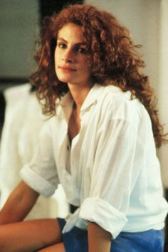 Julia Roberts starring in Pretty Woman. A look back at the permanent waves and curls that dominated classic movies and concert stages in the '70s, '80s and '90s here.