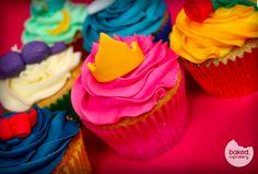 Multi coloured princess cupcake icing with disney princess clues on top