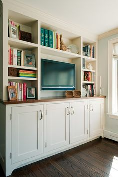 built-in with bottom shaker-style cabinets, natural wood top, open shelving top to ceiling