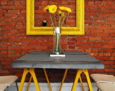 yellow frame on brick wall