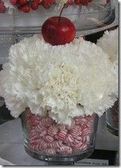 Carnation cupcake but with a candycane sticking out of the top