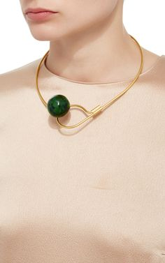 This **Marni** necklace features a structured circular design and an emerald-hued stone.