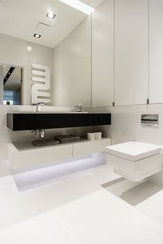 Twin floating vanities in black and white in the bathroom