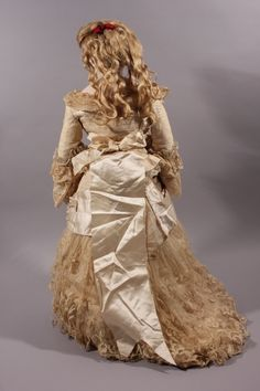 A most stunning Victorian bride doll. Dressed in her original bridal ensemble, this Poupee is one of the most beautiful Portrait Fashion dolls we have seen. She has a delicate bisque socket head on a pressed bisque shoulder plate with her original kidskin body gusseted at the hips, elbows and knees, and stitched kidskin arms, hands, legs and feet.   eBay!