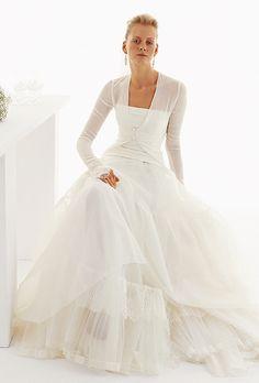 Brides: Le Spose Di Gi�. Chiffon bolero, on a strapless organza full skirt.