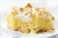 Lemon Earthquake Cake starts with a layer of macadamia nuts and coconut, followed by a lemon cake and cream cheese swirl, baked with white chocolate chips.