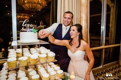 Bride and Groom hold hands and cut cake together during reception in Mission Ballroom at Bahia Resort #weddingphotography / top local photographers
