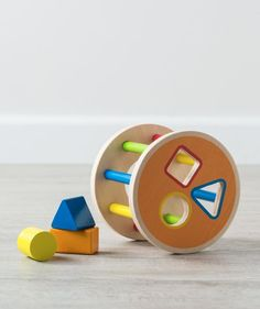 The My 1st Shape Sorter is brightly colored and built to last with sturdy, thick wooden pieces. The circle, triangle and rectangle primary shapes fit snugly, but can be easily pulled back out for another puzzle round! The Shape Sorter is one of the newest in our line of handcrafted wooden toys and instruments designed to fascinate your baby girl and boy. Suitable for ages 12 months and up.