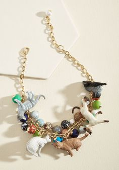 <p>With this statement necklace from Lenora Dame, your affinity for furry friends is on display for everyone to admire! An eccentric mix of colorful beads in patterns aplenty accompany the various kitty figurines of this gold-chain adornment, creating the perfect homage to your treasured pet.</p>