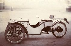 Lord K's Garage #167: Morgan Three Wheeler - Dieselpunks.  Cream and Black/Brown. The car which started it all for Morgan