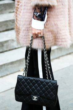 Classic quilted black #Chanel bag Street Style atSpring Summer 2014ParisHaute #Couture