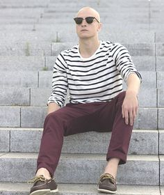 Marine nautical style men's fashion. Red pants, boat shoes sperry top sider and tshirt breton.