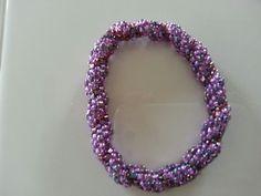 Purple spiral bangle.