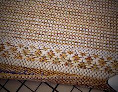 Steps for finishing rag rug hems. How-to pics.