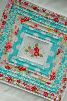 Scrappy Potholders - cute and fresh design with great texture! #quilted #sewing