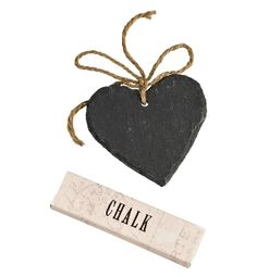 Slate hearts with chalk - £10 for 4. You could use them to label the cake table, tea stand, guest book etc.