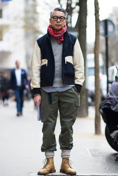 Shop this look on Lookastic: https://lookastic.com/men/looks/bomber-jacket-crew-neck-sweater-long-sleeve-shirt/15377 — Red Plaid Scarf — Grey Crew-neck Sweater — Navy and White Bomber Jacket — Navy and White Gingham Long Sleeve Shirt — Olive Cargo Pants — Grey Socks — Tan Leather Brogue Boots