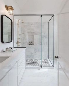 Black And White Modern Shower - Design photos, ideas and inspiration. Amazing gallery of interior design and decorating ideas of Black And White Modern Shower in bathrooms, laundry/mudrooms by elite interior designers. Bathroom Tile Designs, Bathroom Trends, Modern Bathroom Design, Bathroom Interior Design, Bathroom Ideas, Shower Designs, Basement Bathroom, Master Bathroom, Tiled Bathrooms