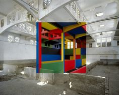 This is no photoshop. Georges Rousse actually paints the projection in a space in a colour and photographs them from the same angle. Stunning