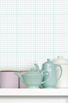 A contemporary geometric wallpaper design which has been inspired by traditional graph paper, found in old school books.