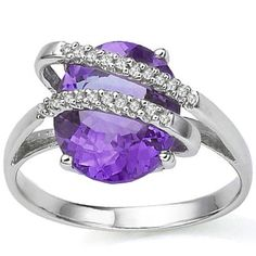 This is a beautiful, vintage Cocktail Ring, .925 Sterling Silver Ring with Platinum. The stone is a true Amethyst stone, wrapped with silver encased White Diamonds. The Amethyst is around 3.25 CT in an oval cut, with very good clarity and a floral lavender color.