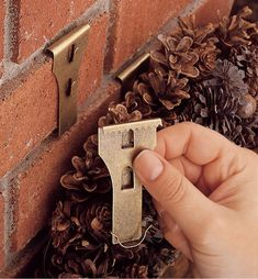 Brick Clip® - Lee Valley Tools Brick clips- Hang on brick without drilling. Great for outdoor wreaths and garland or throughout the year! Outdoor Wreaths, Wreaths And Garlands, Outdoor Christmas Wreaths, Outdoor Garland, Outdoor Christmas Decorations, Halloween Decorations, Brick Clips, Do It Yourself Inspiration, Lee Valley
